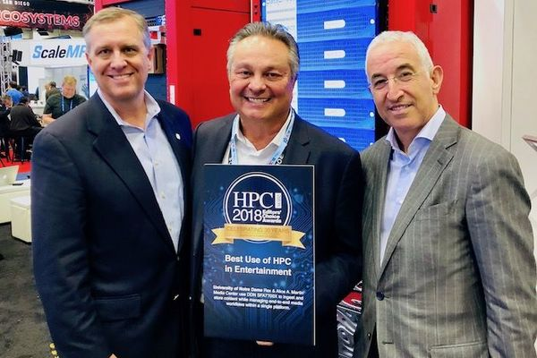 Scott Rinehart, Director of Media Technology for ND Studios (left) receives the award from Tabor Communications Chief Executive Officer Tom Tabor (center) and DataDirect Networks President and Co-founder Paul Bloch (right).